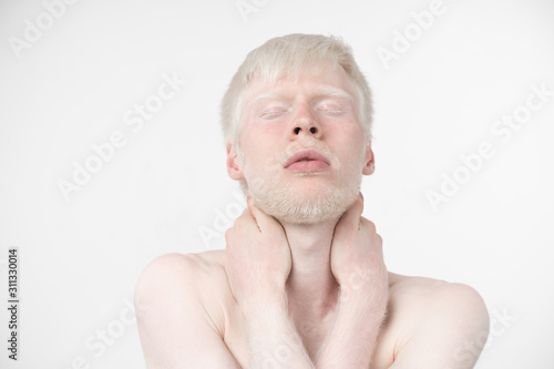 Fototapeta portrait of an albino man in  studio dressed t-shirt isolated on a white background