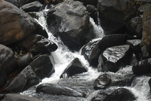 A Small Waterfall Between The Rocks