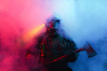 Fireman With Axes In The Smoke.