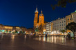Nigt view of the main square and old town architecture. travel and tourism concept, central market square of Krakow, Poland Bazylika Mariacka. Romantic atmosphere. Copy space