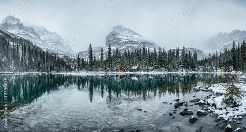 Canvastavla Wooden lodge in pine forest with heavy snow reflection on Lake O'hara at Yoho na