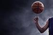 Leinwanddruck Bild - Basketball player spinning a ball