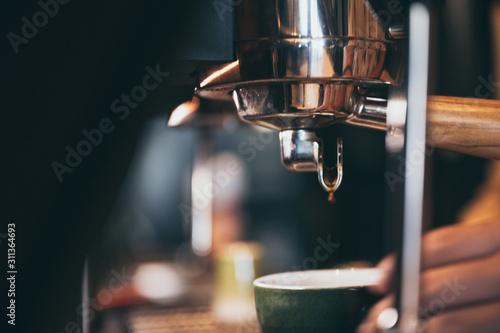 фотография Close-up of espresso pouring from coffee machine