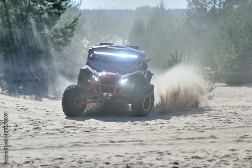 Photo ATV and UTV adventure. Buggy extreme riding in the Sand Dunes