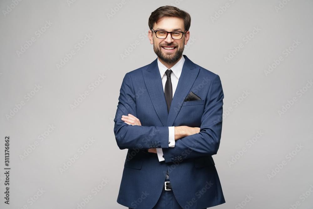 Fototapeta studio photo of young handsome businessman wearing suit