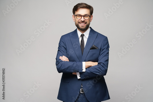 studio photo of young handsome businessman wearing suit Wallpaper Mural