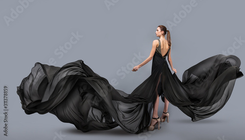 Stampa su Tela beautiful young girl in flying black dress