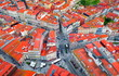 canvas print picture - crossroads or road junction in a European city, red roofs top view, portuguese houses and architecture