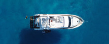 Aerial Drone Top Down Ultra Wide Photo Of Small Yacht Docked In Tropical Exotic Turquoise Sea