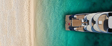 Aerial Drone Top View Ultra Wide Photo Of Luxury Yacht Docked Near Exotic Sandy Turquoise Beach
