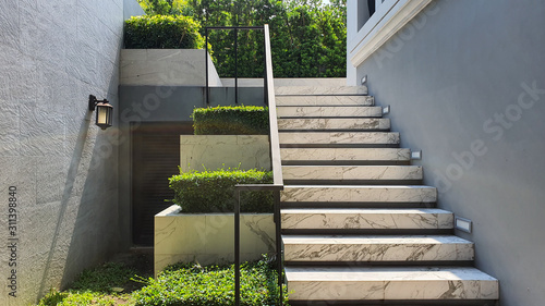White marble stairs and plant pots.