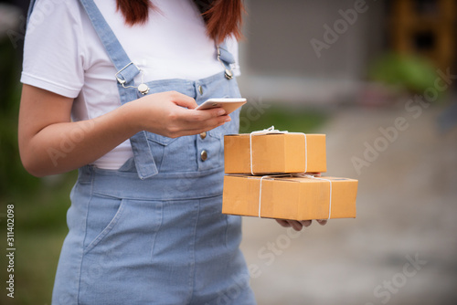 Photo Selective focus  woman appending signature in digital mobile phone after receiv