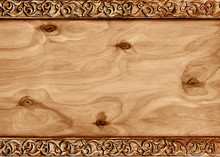 Wooden Frame With Pattern Of Flower Carved On Wood.