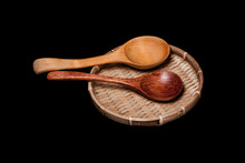 Round Wicker Bowl With Two Wooden Spoons.