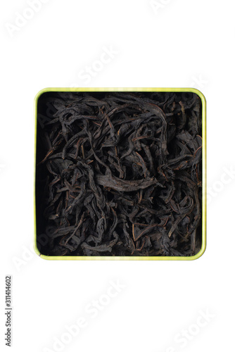 Photo Large fermented willow-tea leaves in a square tin can