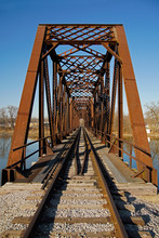 Looking Down The Tracks Of A Rusty Steel Train Bridge Over The Wabash River In Logansport Indiana
