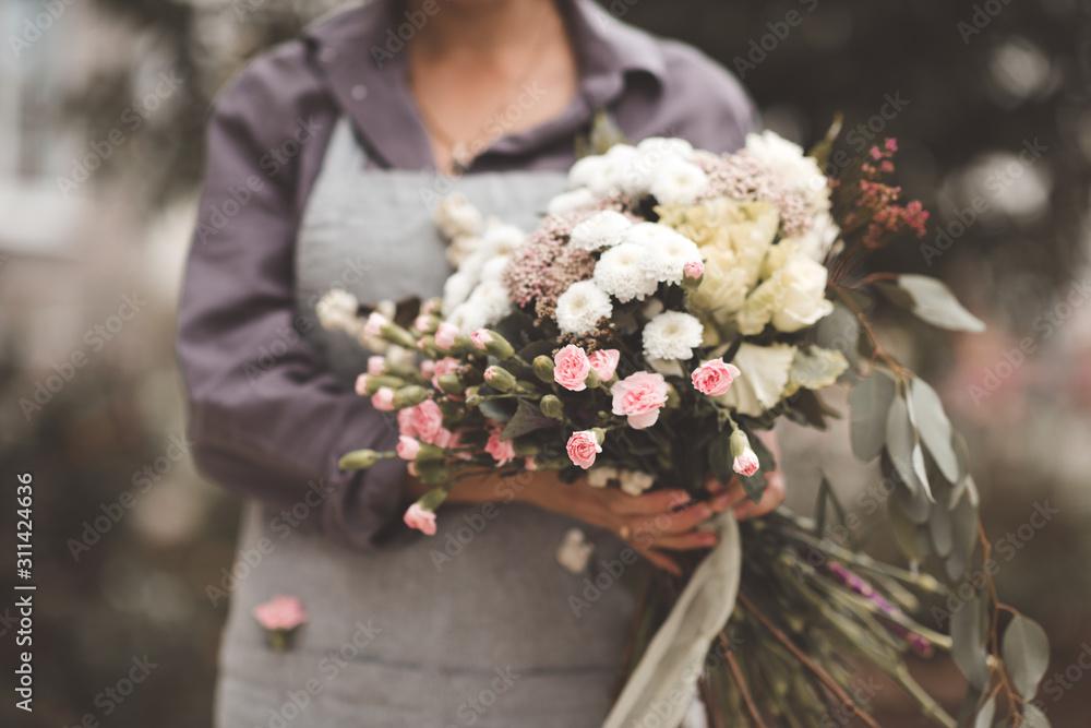 Fototapeta Woman florais holding big bouquet with fresh flowers closeup. Spring season.