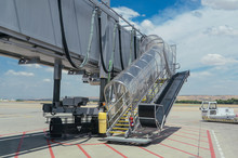 View Of A Jet Bridge. This Boarding Gate Is A Mobile Mechanism To Connect The Airport Gate To The Plane.
