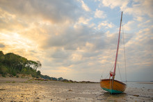 A Sail Boat Resting A Low Tide