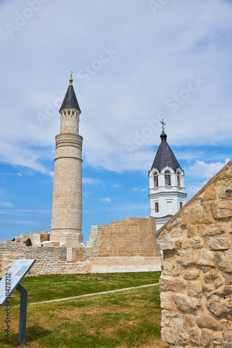 The minaret of the mosque and the Orthodox Church in the Bulgar historical and archaeological monument near Kazan Wallpaper Mural
