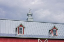 Red Roof Of Old Farm House