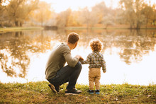 Photo Of Father And Son Having Time Together In Park During Autumn