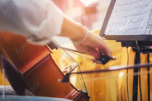 Tableau sur Toile Musician is practicing cello in a music practice classroom prepare for performing violin stage