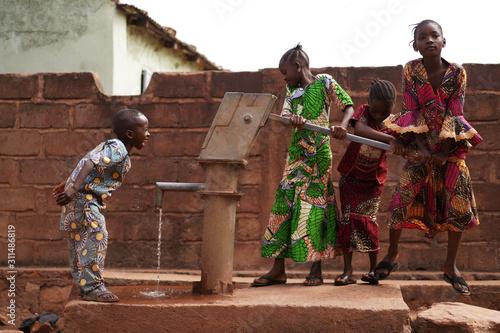 Fototapeta African Children Having Fun At The Water Pump obraz