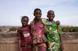 Leinwandbild Motiv Three Pleasant African Girls Posing For A Panorama Picture On a Bridge