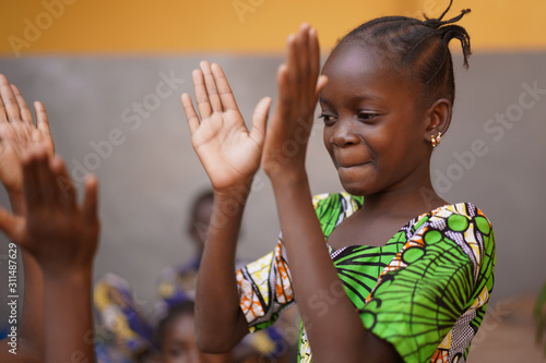 Fototapeta Young African Girl Concentrating On Her Hand Clapping Game obraz