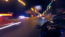 A Dark-colored Car Is Moving R...