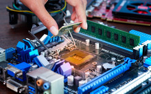 Engineers Are Placing The CPU On The Sockets Of The Computer Motherboard.