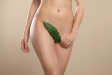 Woman With Leaf Showing Smooth Skin On Beige Background, Closeup. Brazilian Bikini Epilation
