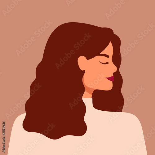 Portrait of a strong beautiful woman in profile with brown hair Tableau sur Toile
