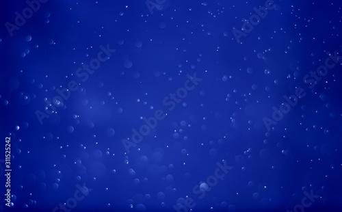 Fototapeta Abstract bokeh light sparkle on dark blue background obraz