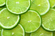canvas print picture - Close-up juicy Lime slices abstract background in pastel green color. Bright summer texture.