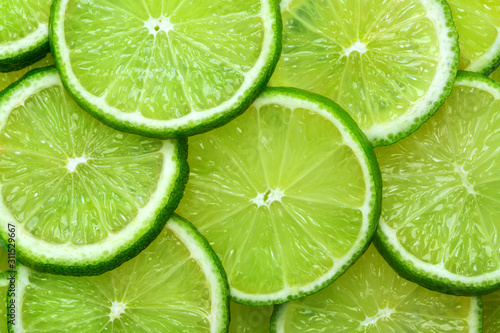 Valokuva Close-up juicy Lime slices abstract background in pastel green color