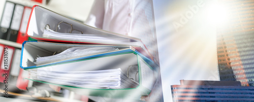 Businesswoman holding binders; multiple exposure Tableau sur Toile
