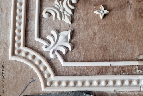 a beautiful decorative detail of stucco in the Indian temple under construction Wallpaper Mural