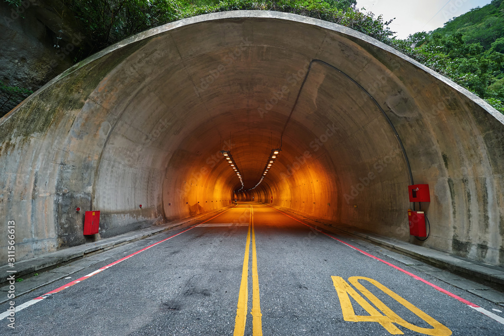 Fototapeta Entrance into the long tunnel in the mountains
