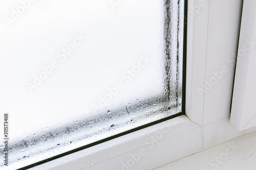 Plastic window with damp and water condensation on glass Tablou Canvas