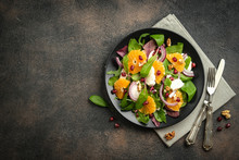 Detox Salad With Tangerines, Mozzarella, Herbs, Pomegranate Seeds And Nuts On A Dark Background. Free Copy Space. Top View.