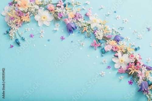 Fototapeta spring flowers on paper background obraz