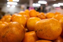 Orange Fruit Stacked On The Ma...