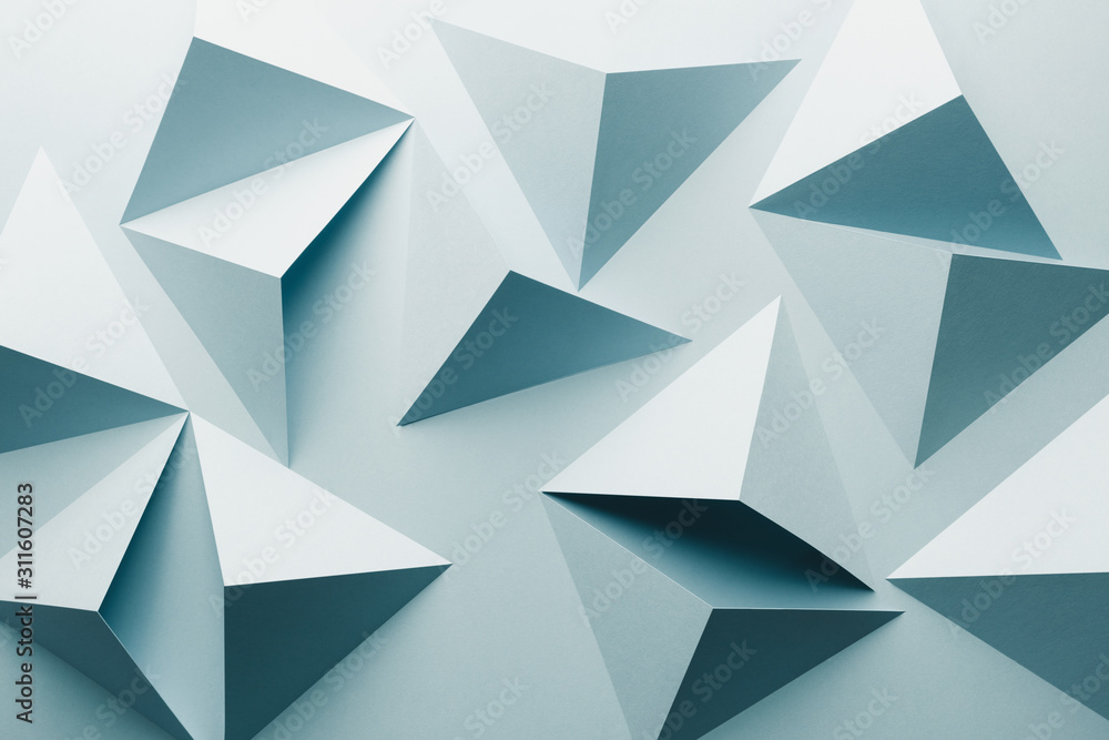 Abstract pattern made of colored paper, light blue background
