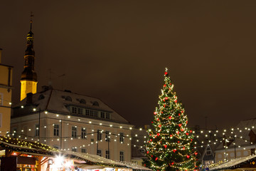 Christmas tree with decorations and lights, european Christmas market at night