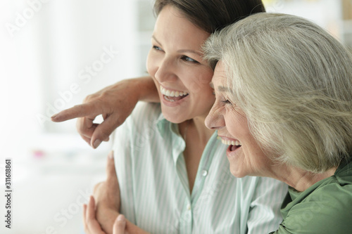 Obraz Close up portrait of senior woman with daughter at home - fototapety do salonu