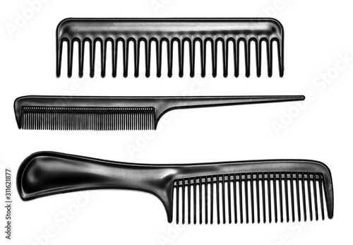Fotomural Black hair combs isolated on a white background