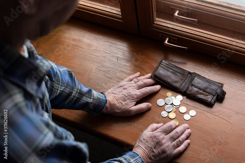 Hands of an old man and counting money, coins Canvas Print