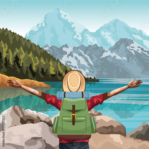 Fototapeta beautiful landscape with traveler man with his arms wide open obraz